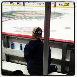 Ewanyk doing his pregame thing on the Barons bench.